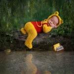 "alt=""newborn-winnie-the-pooh-composite with frog"""